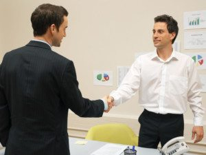 CMO shaking hands with a market influencer that runs a popular blog