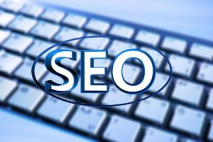 SEO concept image with the acronym SEO on top of a keyboard